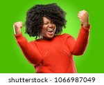 beautiful african woman happy... | Shutterstock . vector #1066987049