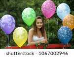 girl and balloons in the park | Shutterstock . vector #1067002946