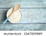 bowl with tasty yogurt on... | Shutterstock . vector #1067005889