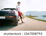 man traveler on cabriolet car... | Shutterstock . vector #1067008793