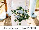 bouquet of the bride in hands ... | Shutterstock . vector #1067012030