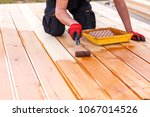 painting a terrace board... | Shutterstock . vector #1067014526