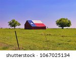 an old barn painted with a... | Shutterstock . vector #1067025134