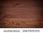 dark brown wooden background... | Shutterstock . vector #1067035193
