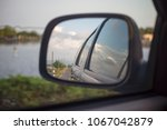 the scenery in the auto glass... | Shutterstock . vector #1067042879