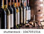 wine bottles in row and oak... | Shutterstock . vector #1067051516