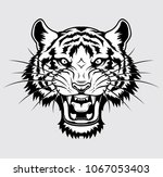 tiger head logo | Shutterstock .eps vector #1067053403