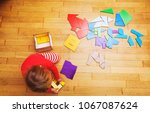 little girl playing with puzzle ... | Shutterstock . vector #1067087624