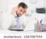 young male worker having... | Shutterstock . vector #1067087954
