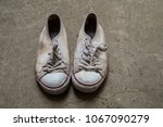 very dirty white shoes on the... | Shutterstock . vector #1067090279