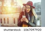 photo of a woman using smart... | Shutterstock . vector #1067097920
