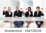 Group of panel judges holding perfect score signs - stock photo