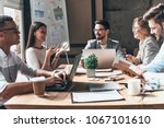 working together. group of... | Shutterstock . vector #1067101610