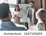 developing new strategy. two... | Shutterstock . vector #1067105603
