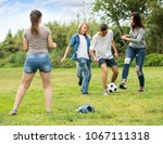 group of cheerful active... | Shutterstock . vector #1067111318
