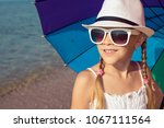 one happy little girl with... | Shutterstock . vector #1067111564
