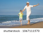 father and son playing on the... | Shutterstock . vector #1067111570