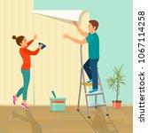 man and woman glues wallpaper...   Shutterstock .eps vector #1067114258