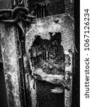 Small photo of Old lock of a gate corroded by the marine climate