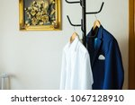 the bridegroom's jacket on the... | Shutterstock . vector #1067128910