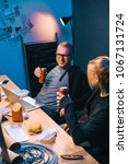 Small photo of couple of hackers drinking beer during malware development