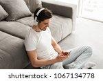 modern man 30s in white t shirt ... | Shutterstock . vector #1067134778