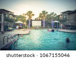 blurred pool party at apartment ... | Shutterstock . vector #1067155046