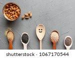 superfood in spoons over gray... | Shutterstock . vector #1067170544