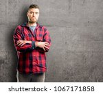 young handsome man nervous and... | Shutterstock . vector #1067171858