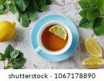 lemon balm tea with honey. cup... | Shutterstock . vector #1067178890