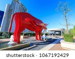 Small photo of Manila, Philippines - Feb 24, 2018 : Red carabao sculpture at SM Aura Premier, Shopping mall in Taguig, Philippines
