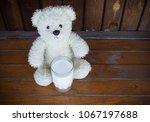 teddy bear with milk drain on... | Shutterstock . vector #1067197688