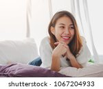 young asian woman smiling... | Shutterstock . vector #1067204933
