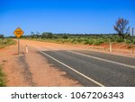 finish of road. yellow sign... | Shutterstock . vector #1067206343