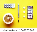 pills  thermometer on a yellow... | Shutterstock . vector #1067209268