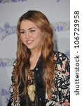 "LOS ANGELES, CA - FEBRUARY 8, 2011: Miley Cyrus at the Los Angeles premiere of her new movie ""Justin Bieber: Never Say Never"" at the Nokia Theatre LA Live. February 8, 2011  Los Angeles, CA - stock photo"