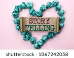Small photo of Writing note showing Story Telling. Business photo showcasing Tell or write short Stories Share Personal Experiences written Cardboard Piece Heart the light pink plain background.