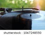 old retro vinyl record player... | Shutterstock . vector #1067248550
