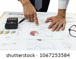 Small photo of Businessman Summary report and capital market analyzing money market plan Review accounting data and calculate production income.