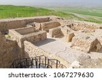Small photo of reconstructed Israelite temple in the Judean fortress of Tel Arad, Israel with Bedouin Villages in the background