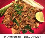 fried rice with vegetables is...   Shutterstock . vector #1067294294