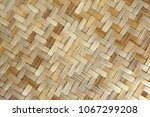 bamboo or straw weaving texture ... | Shutterstock . vector #1067299208