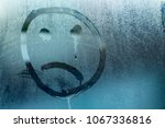 Image Of A Crying Face On A...