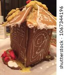 Small photo of Screw up awry gingerbread House with bad looking frosting
