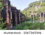 roman aqueduct abadoned  in the ... | Shutterstock . vector #1067365346