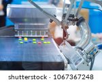 automatic robot in assembly... | Shutterstock . vector #1067367248