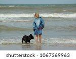 blonde girl is standing in the... | Shutterstock . vector #1067369963