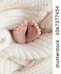 close up of newborn baby feet.... | Shutterstock . vector #1067377454