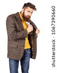 Small photo of portrait of bearded businessman hiding a wad of money in his jacket pocket. human emotion expression and office, business, finances concept