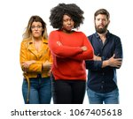 group of three young men and... | Shutterstock . vector #1067405618